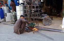 October 2, 2018 - Pakistan - QUETTA, PAKISTAN, OCT 01: Labour busy in cutting iron rods to earn his livelihood for .support of his family, at his workplace in Quetta on Monday, October 01, 2018. (Credit Image: © PPI via ZUMA Wire)