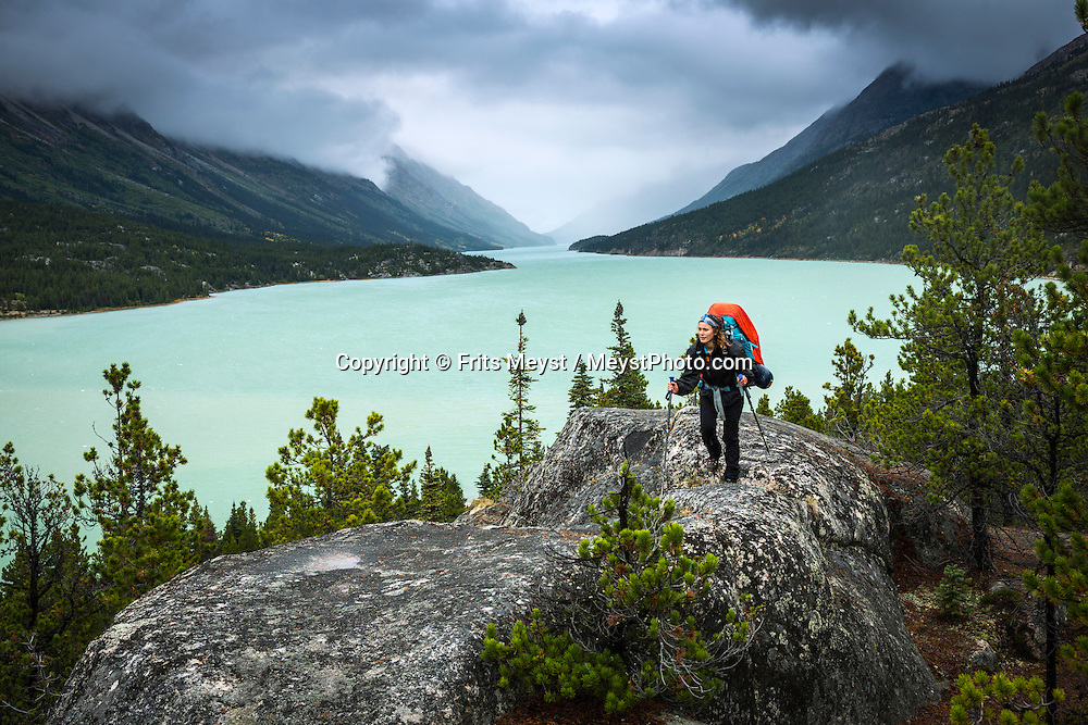Alaska, USA to Yukon Territory, Canada, September 2014. Dark clouds and storm over Lake Bennett. The last leg of the epic journey from Lindeman City to Lake Bennett, where a floatplane will pick us up. Starting at Dyea, Alaska, The Chilkoot Trail retraces the Klondike Gold Rush route that most stampeders followed to get to the gold fields. Steeped in Klondike Gold Rush history and scattered with relics from the past, the famous Chilkoot Trail is also referred to as the longest open air museum in the world. This rugged 55 kilometer wilderness trek is a world-renowned hiking trail and Canada's largest National Historic Site. Photo by Frits Meyst / MeystPhoto.com