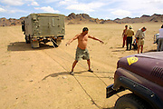 GOBI DESERT, MONGOLIA..08/29/2001.Mount Burkhan Khailaast. Kitchen truck towing Jeep of Nomads Tours with defective generator..(Photo by Heimo Aga).