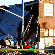 Building collapse at 18th & Oak Streets in Kansas City, Missouri after a car chase resulted in a vehicle crashing into an old building, causing it to cave in.