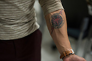 DALLAS, TX - AUGUST 11: A member of Foxtrot shows his tattoo for his fallen partners at the Southwest Patrol Division in Dallas, Texas on August 11, 2016. (Photo by Cooper Neill for The Washington Post)