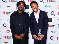 Sampha and Sheku Kanneh-Mason pose backstage during the O2 Silver Clef Awards 2019, Grosvenor House, London, UK, Friday 05 July 2019<br /> Photo JM Enternational