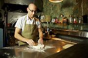 JERSEY CITY, NJ - FEBRUARY 12, 2014: Chef Dan Richer of Razza Pizza Artigianale kneading pizza dough. CREDIT: Clay Williams for Edible Jersey.<br /> <br /> <br /> &copy; Clay Williams / http://claywilliamsphoto.com