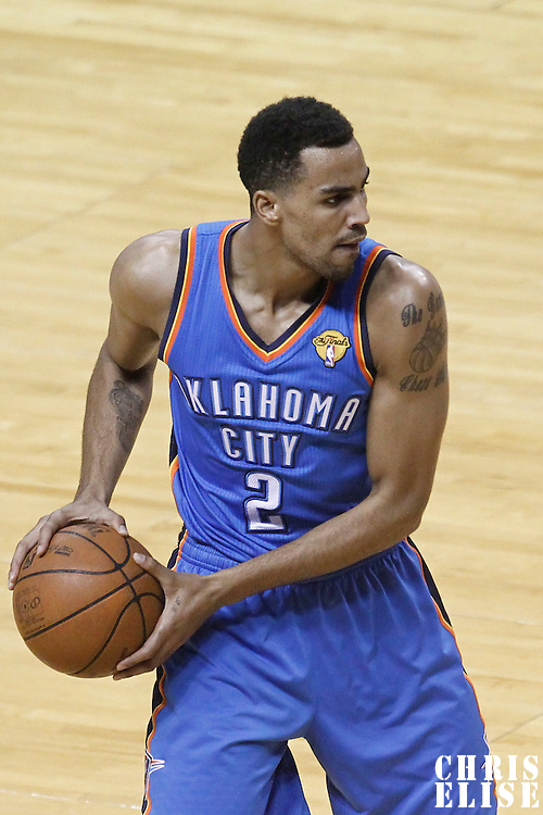 21 June 2012: Oklahoma City Thunder shooting guard Thabo Sefolosha (2) looks to pass the ball during the Miami Heat 121-106 victory over the Oklahoma City Thunder, in Game 5 of the 2012 NBA Finals, at the AmericanAirlinesArena, Miami, Florida, USA. The Miami Heat wins the series 4-1.