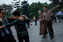 Locals practice classical dance early in the morning in the center of Hanoi, Vietnam, Southeast Asia