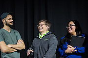 From left to right, David Lawrence, Julie Suhr, and Melissa Figueroa, laugh on stage during the 2018 Faculty Pageant.