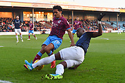 Scunthorpe United midfielder Duane Holmes (19) and Southend United forward Marc-Antoine Fortune (9) during the EFL Sky Bet League 1 match between Scunthorpe United and Southend United at Glanford Park, Scunthorpe, England on 23 December 2017. Photo by Ian Lyall.