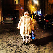 Rome 2015: elderly woman walking dowtown Rome