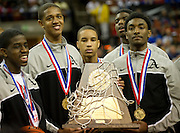 Dallas Triple A Academy celebrates with their trophy after defeating Mumford in the UIL 1A division 1 state championship game at the Frank Erwin Center in Austin on Saturday, March 9, 2013. (Cooper Neill/The Dallas Morning News)