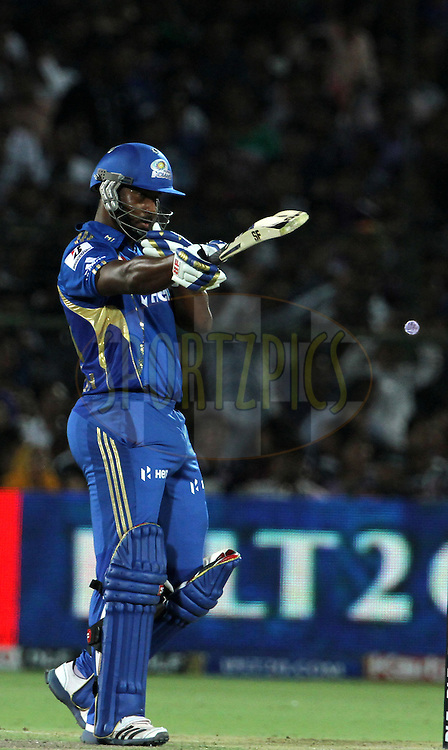 Mumbai Indian player Dwayne Smith raises his bat after scoring a fifty during match 72 of the Indian Premier League ( IPL) 2012  between The Rajasthan Royals and the Mumbai Indians  held at the Sawai Mansingh Stadium in Jaipur on the 20th May2012..Photo by Vipin Pawar/IPL/SPORTZPICS