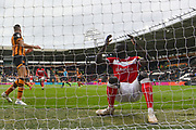 Bristol City striker Famara Diedhiou (9) in despair at missed shot at goal going over the bar during the EFL Sky Bet Championship match between Hull City and Bristol City at the KCOM Stadium, Kingston upon Hull, England on 5 May 2019.