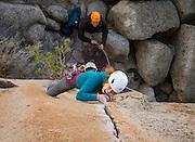 Hannah Hall fighting her way up Espresso Crack, 5.11+. <br /> Bishop, California.