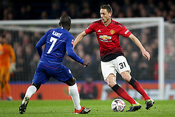 Chelsea's N'Golo Kante (left)and Manchester United's Nemanja Matic battle for the ball during the FA Cup fifth round match at Stamford Bridge, London.