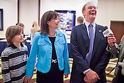02 NOVEMBER 2010 - PHOENIX, AZ: The Goddards, Kevin, Monica and Terry, stop for a radio interview on their way into the ballroom on election night at the Wyndham Hotel in Phoenix Tuesday.  Goddard lost the election to sitting Governor Jan Brewer, a conservative Republican.     PHOTO BY JACK KURTZ