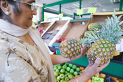 Older woman out shopping for fruit,