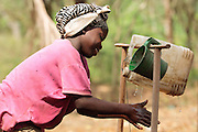 A girl washes her hands at a pedal-activated hand washing station outside a home latrine in the village of Kawejah, Grand Cape Mount county, Liberia on Friday April 6, 2012. As part of the UNICEF sponsored CLTS programme, communities learn to put in practice good hygiene and sanitation practices.
