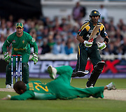 Shoaib Malik drives back past bowler Jean-Paul Duminy during the ICC World Twenty20 Cup semi-final between South Africa and Pakistan at Trent Bridge. Photo © Graham Morris (Tel: +44(0)20 8969 4192 Email: sales@cricketpix.com)