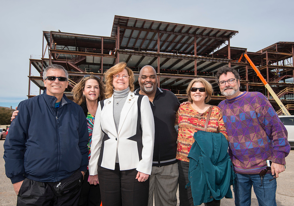DeBakey High School for Health Professionals alumni pose for a photograph after signing a beam that will help support the entry to the new school, January 27, 2016.