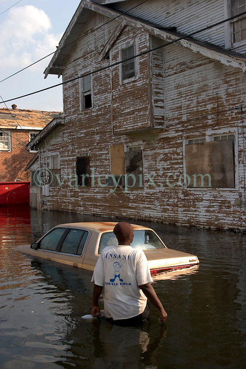 05 Sept  2005. New Orleans, Louisiana. Post hurricane Katrina.<br /> Residents who refuse to leave. A lady wades through the water where some residents of Uptown New Orleans refuse to leave the devastated flood areas.<br /> Photo; &copy;Charlie Varley/varleypix.com