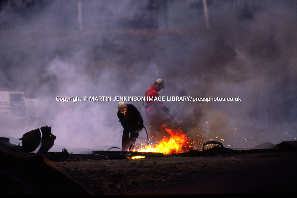 Burning scrap with a gas torch during the demolition of British Steel Corporation's Orgreave works.