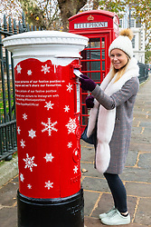 "Today, Royal Mail launches its first ever 'singing' postbox in Greenwich, which plays one of a selection of three Christmas-themed ditties when a letter or card is posted. Four 'singing' festive postboxes in total will be launched across locations in England, Scotland, Wales and Northern Ireland, and will be in place throughout December."". Greenwich, London, November 23 2018."