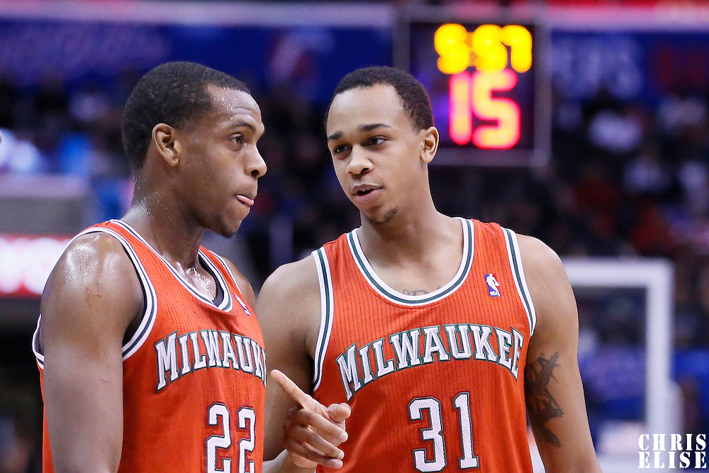 24 March 2014: Milwaukee Bucks center John Henson (31) talks to Milwaukee Bucks forward Khris Middleton (22) during the Los Angeles Clippers 106-98 victory over the Milwaukee Bucks at the Staples Center, Los Angeles, California, USA.