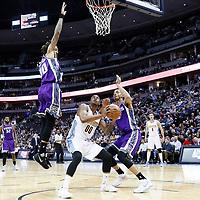 06 March 2017: Denver Nuggets forward Darrell Arthur (00) eyes the basket as Sacramento Kings center Willie Cauley-Stein (00) jumps next to Sacramento Kings forward Skal Labissiere (3) during the Denver Nuggets 108-96 victory over the Sacramento Kings, at the Pepsi Center, Denver, Colorado, USA.