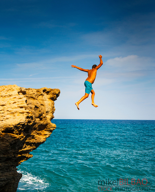 Cliff jump. Cala Moreta. Begur. Costa Brava, Gerona. Catalonia, Spain, Europe