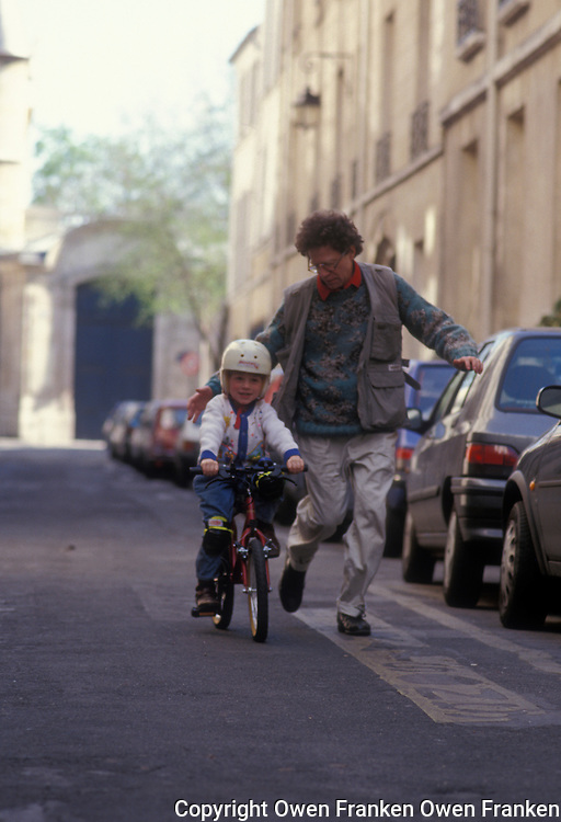 owen teaching tunui to ride a bike