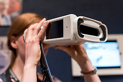 "© Licensed to London News Pictures. 11/09/2018. LONDON, UK. A staff member tests ""Quicksee"", designed by PlenOptika, a portable eye test device for use in developing countries, at a preview of the 87 nominees for the eleventh Beazley Designs of the Year exhibition and awards at the Design Museum in Kensington.  The exhibition runs 12 September to 6 January 2019 and celebrates the most innovative designs of the last year.  Photo credit: Stephen Chung/LNP"