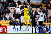 Port Vale defender Danny Pugh (12) challenges AFC Wimbledon midfielder Jake Reeves (8)  during the EFL Sky Bet League 1 match between Port Vale and AFC Wimbledon at Vale Park, Burslem, England on 1 April 2017. Photo by Simon Davies.