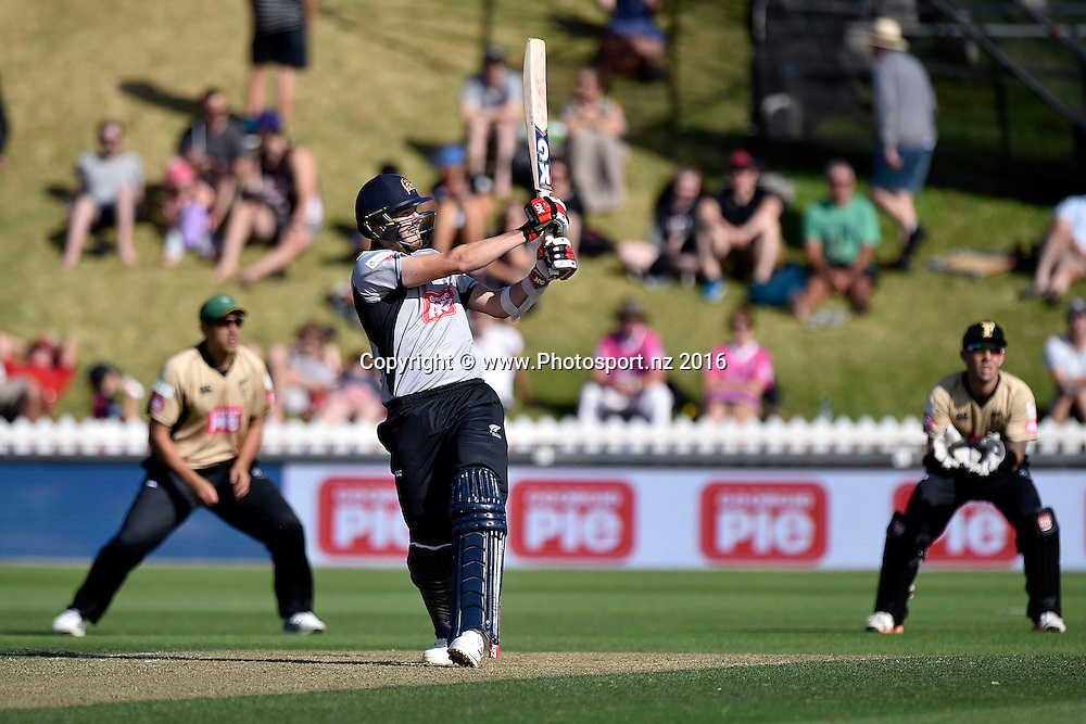 Jacob Duffy (C of the South Island plays a shot watched by Ross Taylor (L) and Luke Ronchi (R of the North Island during the North Island vs South Island cricket match at the Basin Reserve in Wellington on Sunday the 28th of February 2016. Copyright Photo by Marty Melville / www.Photosport.nz
