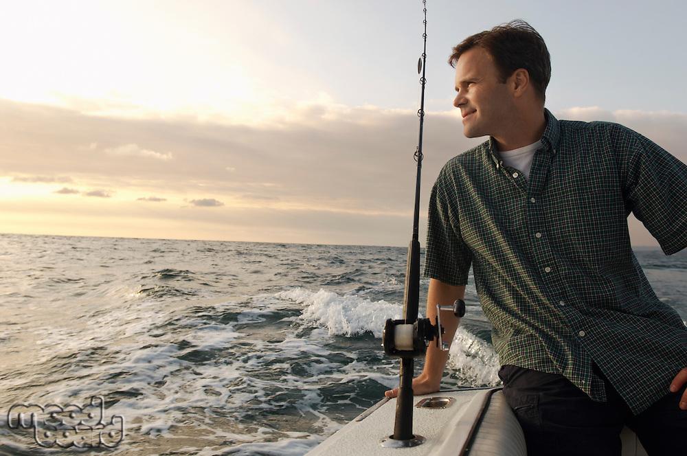Fisherman on boat at sea