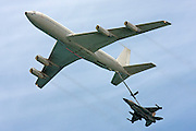 An Israeli Air force F16 Fighter jet being refueled by a Boeing 707 in flight.