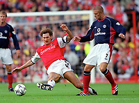 Arsenal captain Tony Adams fouls Manchester Uniteds David Beckham. Arsenal 1:0 Manchester United, F.A.Carling Premiership, 1/10/2000. Credit Colorsport / Stuart MacFarlane.