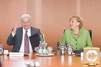 20 AUG 2008, BERLIN/GERMANY:<br /> Frank-Walter Steinmeier (L), SPD, Bundesaussenminister, und Angela Merkel (R), CDU, Bundeskanzlerin, vor Beginn einer Kabinettsitzung, Kabinettsaal, Bundeskanzleramt<br /> IMAGE: 20080820-01-041<br /> KEYWORDS: Kabinett, Sitzung