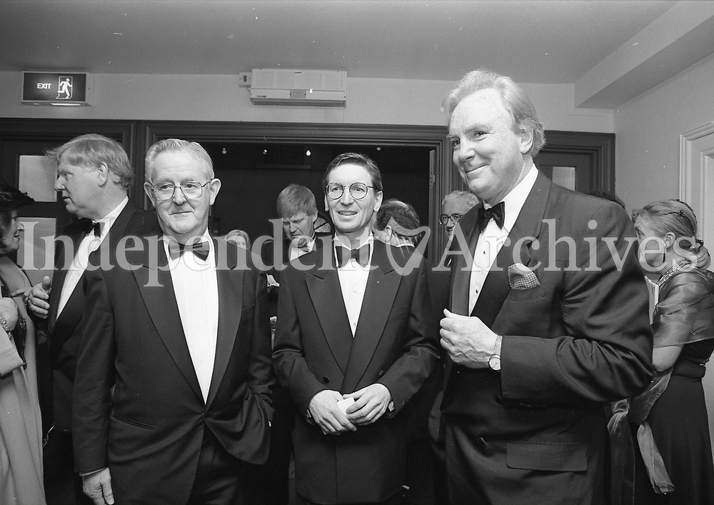 Dr AJF O'Reilly chats with Mr David Montgomery and Mr Liam Healy, Chief Executive of Independent Newspapers, before the start of La Boheme at the Wexford Opera Festival. (Part of the Independent Newspapers Ireland/NLI Collection)