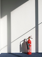 Fire extinguisher casting shadow on wall