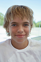 Teenage boy (13-15) smiling outdoors portrait