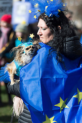 © Licensed to London News Pictures. 10/03/2019. London, UK.  Dog owners and their dogs demonstrate in Westminster with a clear message for politicians to ensure a no-Brexit deal is avoided. Photo credit: Ray Tang/LNP