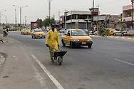 11/10/2014 -- Kirkuk, Iraq -- A Bangladeshi worker cleans the Shorja street in the centre of Kirkuk.