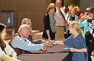 "May 11, 2013 - Garden City, New York U.S. -  Astronaut BUZZ ALDRIN, the second person to walk on the moon, shakes the hand of a young girl at the book signing for his new books ""Mission to Mars"" and the illustrated history of space exploration ""Look to the Stars.""  After Aldrin, the NASA astronaut engineer of Apollo 11 in 1969, gave a Sold Out lecture, people who bought his books at the museum book store could attend the book signing at the LEM room of the Cradle of Aviation Museum."