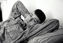 Young man in homeless hostel, Nottingham UK 1989