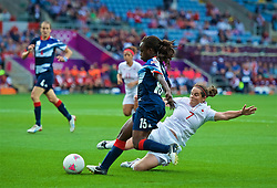 COVENTRY, ENGLAND - Friday, August 3, 2012: Great Britain's Eniola Aluko (L) is tackled by Canada's Rhian Wilkinson during the Women's Football Quarter-Final match between Great Britain and Canada, on Day 7 of the London 2012 Olympic Games at the Rioch Arena. Canada won 2-0. (Photo by David Rawcliffe/Propaganda)