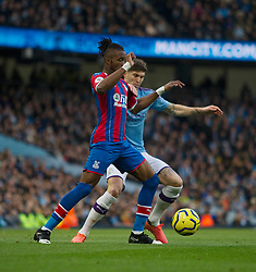 Wilfried Zaha of Crystal Palace (L) and John Stones of Manchester City in action - Mandatory by-line: Jack Phillips/JMP - 18/01/2020 - FOOTBALL - Etihad Stadium - Manchester, England - Manchester City v Crystal Palace - English Premier League