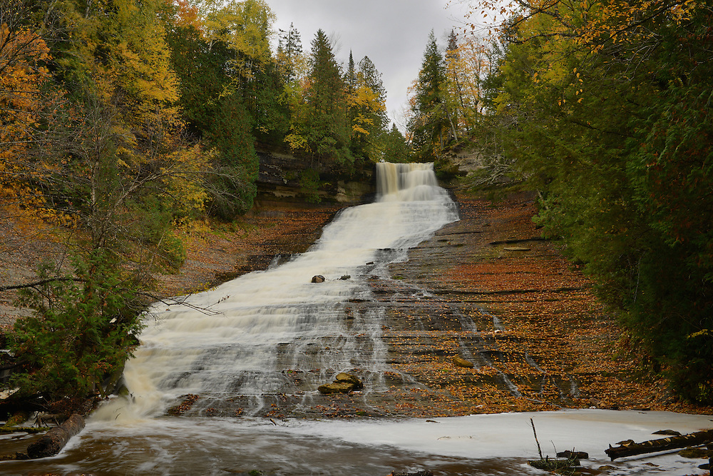 Fallen leaves surround the 100 foot cascade at Laughing Whitefish Falls,<br />