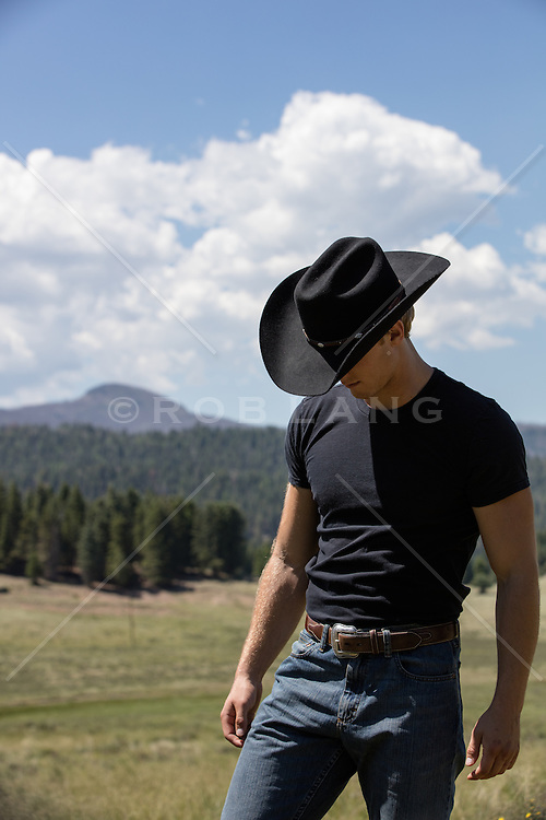 cowboy walking on a mountain range