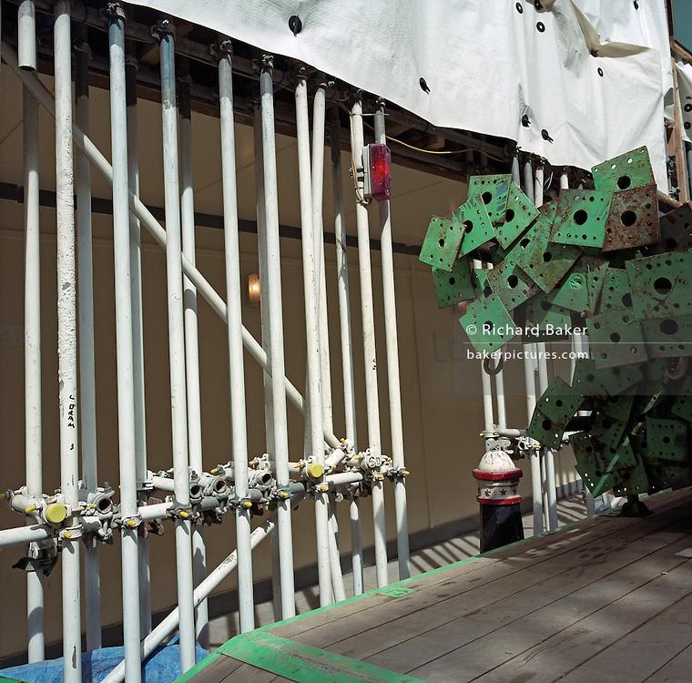 Engineering struts await use near scaffolding on a City of London construction site.