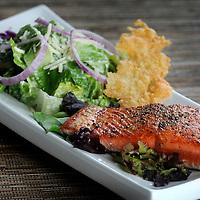 Salmon Caesar Salad with Parmesan tuiles.