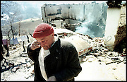 War in Kosovo<br /> a man in front of his destroyed house